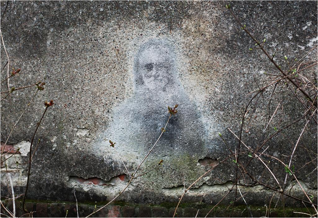 Laserowy portret artysty wykonany na zewnętrznej ścianie jego pracowni